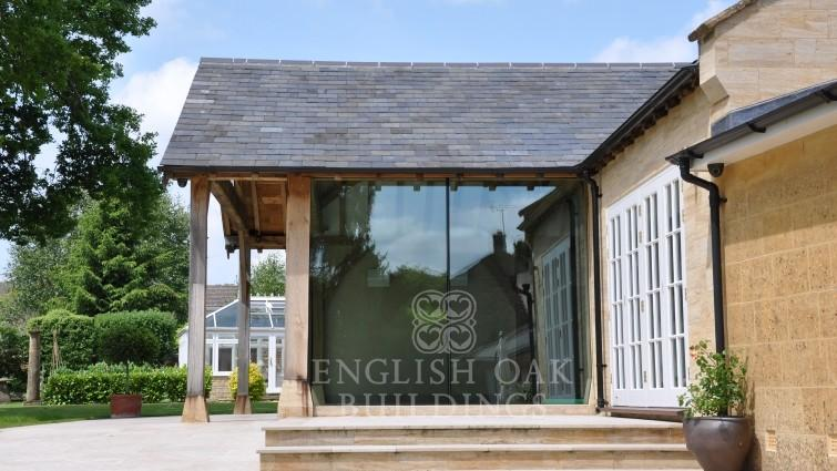 Green oak frame pool cover and structural glass walls