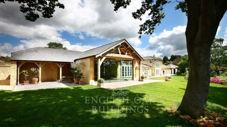 Oak House with stone and oak roof covered swimming pool