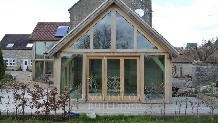 Green Oak Extensions with Direct Glazing and bi-fold oak door