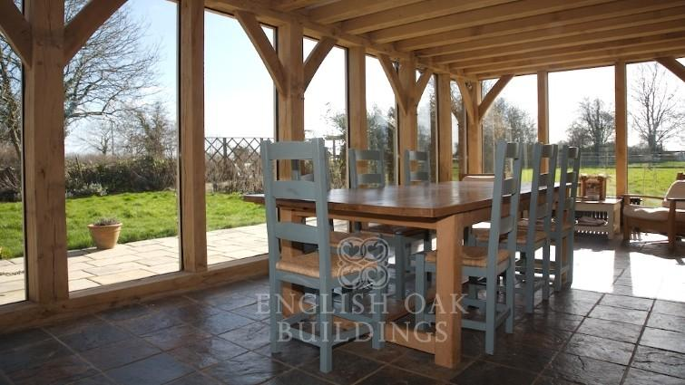 Green oak frame sunroom, conservatory, dinning room with oak joists and glazing