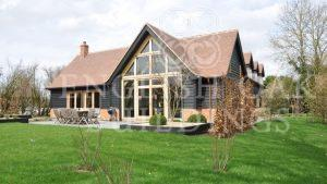 Oak Frame house, brick and larch cladding, Holyport, Berkshire