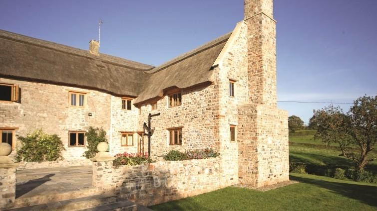 Oak-frame-house-with-stone-walls-755x424